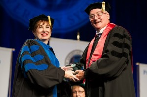Dr. Suzanne Minarcine, faculty director for the School of Business, is presented with The James P. Etter Award by....